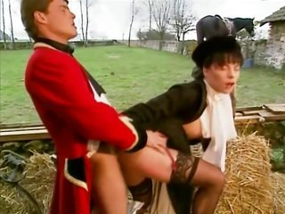A gark-haired seduces a groom in the stables