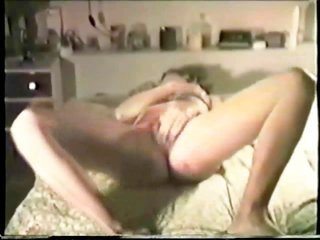 wife enjoyes herself on bed in front of partner