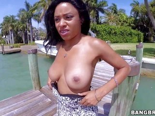 ravishing shaded complexion girl Anya Ivy takes off her raiment by the river moreover positions topless with no degradation. that chick symbolizes off