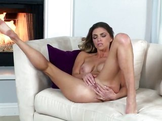 Niki Skyler with drenched knockers furthermore clean-shaven cum-hole is extreme about to posing nude on camera