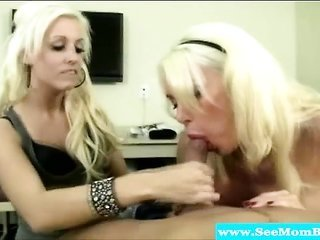 sandy colored milfs blowing on the same rod
