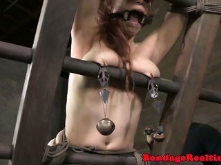Gagged bottom player earns her pussylips stretched