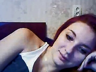 sweetheart redhead maiden teases on her live cam